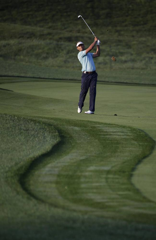 Joost Luiten, of the Netherlands, hits from the fairway on the first hole during the first round of the PGA Championship golf tournament at Valhalla Golf Club on Thursday, Aug. 7, 2014, in Louisville, Ky