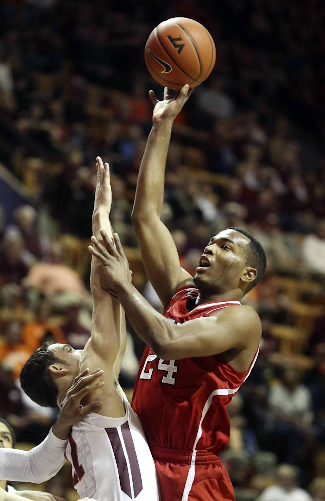 North Carolina State's T.J. Warren (24) shoots over the defense of Virginia Tech's Devin Wilson during the first half of an NCAA college basketball in Blacksburg, Va., Saturday, Feb. 22, 2014