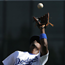 Los Angeles Dodgers second baseman Dee Gordon catches a pop fly by Texas Rangers' Adrian Beltre during an exhibition baseball game in Glendale, Ariz., Friday, March 7, 2014 The Associated Press