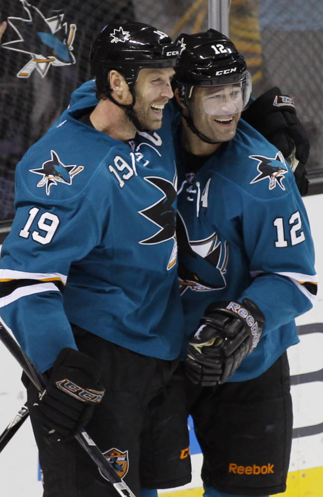 San Jose Sharks' Patrick Marleau, right, celebrates with Joe Thornton after scoring a goal against the Anaheim Ducks during the second period of an NHL hockey game, Saturday, Nov. 30, 2013, in San Jose, Calif