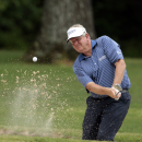 Colin Montgomerie, of Scotland, hits out of the bunker on the sixth hole during the Regions Tradition Champions Tour golf tournament at Shoal Creek Country Club, Saturday, May 16, 2015, in Birmingham, Ala. (AP Photo/Butch Dill)
