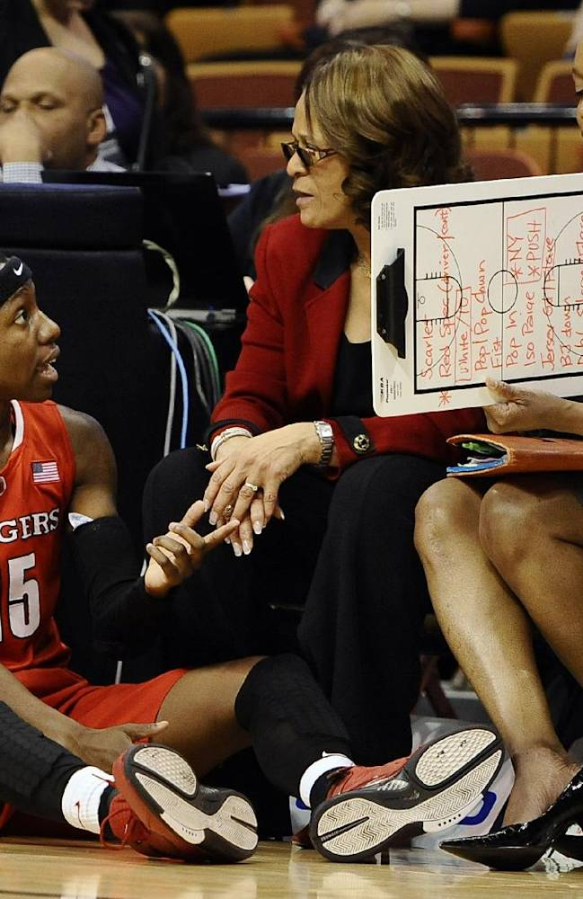 Rutgers' Syessence Davis, left, talks with head coach C. Vivian Stringer, center, and assistant coach Tia Jackson during the second half of an NCAA college basketball game against Connecticut in the semifinals of the American Athletic Conference women's tournament on Sunday, March 9, 2014, in Uncasville, Conn. Connecticut won 83-57