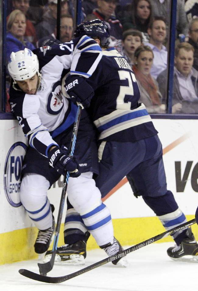 Columbus Blue Jackets' Ryan Murray, right, checks Winnipeg Jets' Chris Thorburn during the first period of an NHL hockey game Monday, Dec. 16, 2013, in Columbus, Ohio