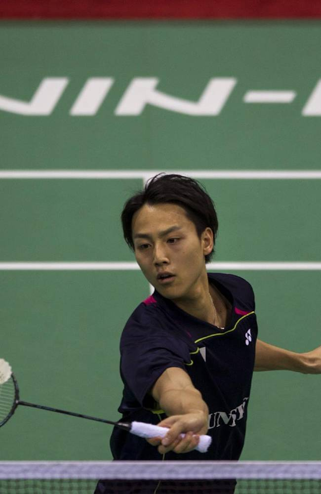 Japan's Takuma Ueda reaches out to return a shot against England's Sam Parsons during their men's singles event of the Thomas Cup Badminton in New Delhi, India, Sunday, May 18, 2014