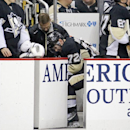 Pittsburgh Penguins' Patric Hornqvist (72) is tended to by a trainer after coming off the ice injured during the second period of an NHL hockey game against the Vancouver Canucks in Pittsburgh, Thursday, Dec. 4, 2014. Hornqvist did not return to action in