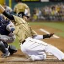 Pittsburgh Pirates' Jose Tabata, right, is tagged out by Houston Astros catcher Jason Castro while trying to score from third on a ground ball hit by Russell Martin in the sixth inning of the baseball game on Saturday, May 18, 2013, in Pittsburgh. (AP Photo/Keith Srakocic)