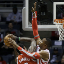 Houston Rockets' Dwight Howard, right, defends against Milwaukee Bucks' Larry Sanders (8) during the first half of an NBA basketball game Saturday, Feb. 8, 2014, in Milwaukee The Associated Press