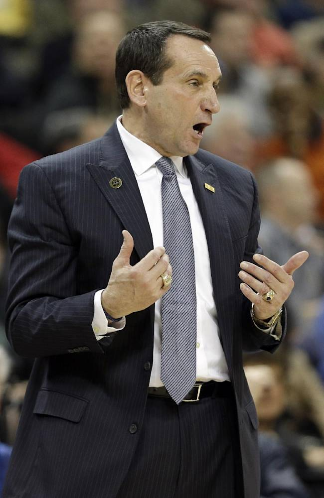 In this photo taken Wednesday, March 5, 2014, Duke head coach Mike Krzyzewski argues a call during the first half  of an NCAA college basketball game against Wake Forest in Winston-Salem, N.C. Coach Krzyzewski is out of the hospital after feeling light-headed after a loss at Wake Forest. The school said in a statement Thursday, March 6, that Krzyzewski was taken to Duke University Hospital in Durham for a precautionary examination after the 82-72 loss in Winston-Salem