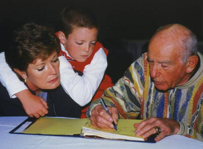 In this Oct. 12, 2000, file photo, provided by the University of Tennessee, Tyler Summitt, center, holds onto his mother, Tennessee women's basketball coach Pat Summitt, as she talks with former NBA coach Jack Ramsay at the Basketball Hall of Fame in Springfield, Mass. Ramsay, a Hall of Fame coach who led the Portland Trail Blazers to the 1977 NBA championship before he became one of the league's most respected broadcasters, has died following a long battle with cancer. He was 89
