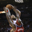 Washington Wizards' Al Harrington (7) is unable to block Miami Heat's Chris Andersen (11) during the first half of an NBA basketball game, Monday, March 10, 2014, in Miami The Associated Press
