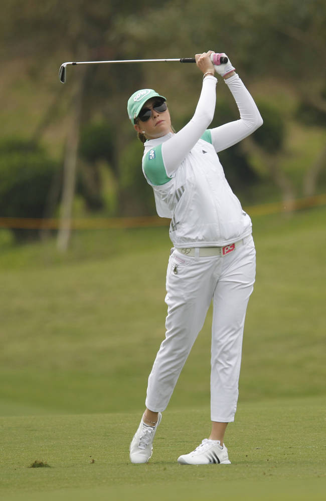 Paula Creamer of the United States, follows her drive down the 1st hole fairway during the second round of the Sunrise LPGA Taiwan Championship tournament at the Sunrise Golf & Country Club, Friday, Oct. 25, 2013, in Yangmei, north eastern Taiwan