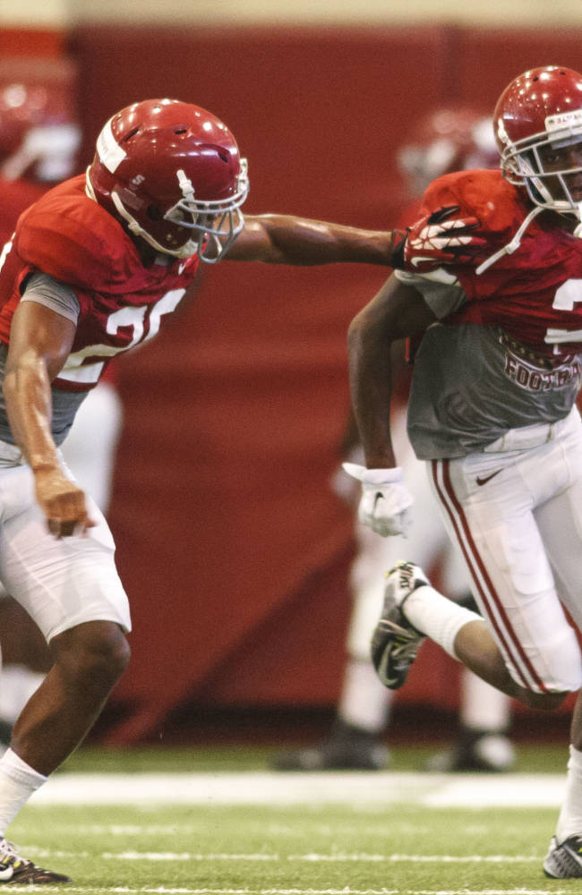 Alabama defensive back Jarrick Williams (20) defends Tony Brown (2) as they work through drills during NCAA college football practice, Thursday, Aug. 21, 2014, in Tuscaloosa, Ala