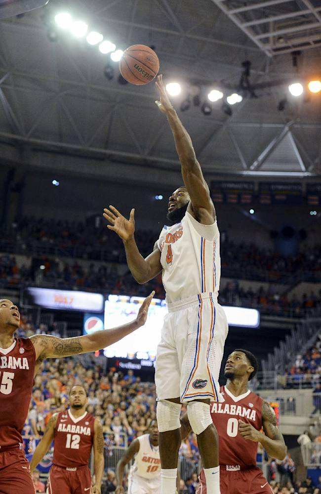 Florida center Patric Young (4) shoots over Alabama forward Nick Jacobs (15) during the first half of an NCAA college basketball game Saturday, Feb. 8, 2014, in Gainesville, Fla