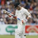 New Zealand's captain Brendon McCullum leaves the pitch after being bowled LBW by England's Stuart Broad in their first test match, at Lord's cricket ground in London, Sunday, May 19, 2013. (AP Photo/Kirsty Wigglesworth)
