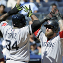 Boston Red Sox batter Mike Napoli, right, celebrates with David Ortiz after Napoli hit a two-run home run during the second inning of a baseball game against the New York Yankees Saturday, Sept. 7, 2013, at Yankee Stadium in New York. (AP Photo/Bill Kostroun)