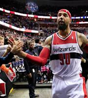 WASHINGTON, DC - MARCH 15: Drew Gooden #90 of the Washington Wizards greets fans following the Wizards 101-94 win over the Brooklyn Nets at Verizon Center on March 15, 2014 in Washington, DC. (Photo by Rob Carr/Getty Images)