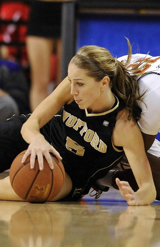 Wofford's Logan Morris, left, grabs a loose ball in front of Maryland's Shatori Walker-Kimbrough during the second half of an NCAA college basketball game Saturday, Dec. 28, 2013, in College Park, Md. Maryland won 110-53