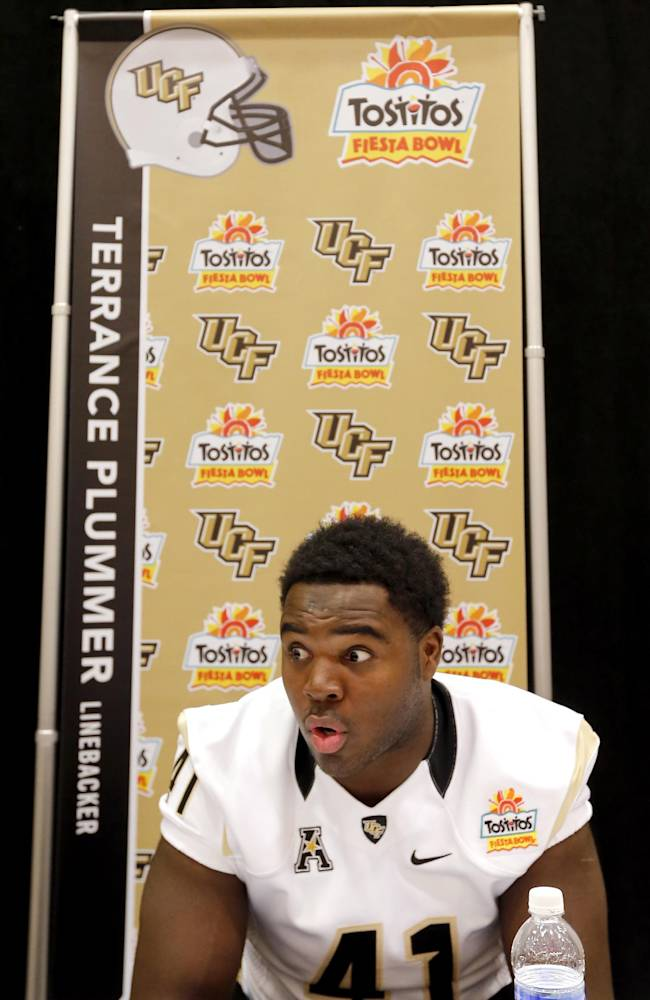 University of Central Florida linebacker Terrance Plummer takes questions during the Fiesta Bowl media Day, Monday, Dec. 30, 2013, in Scottsdale, Ariz. Central Florida will face Baylor on Jan. 1, 2014 in the Fiesta Bowl NCAA college football game