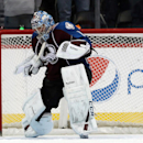 Colorado Avalanche goalie Semyon Varlamov, of Russia, reacts as time runs out in the third period of the Avalanche's 3-2 victory over the San Jose Sharks in an NHL hockey game in Denver on Saturday, March 29, 2014 The Associated Press