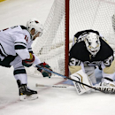 Pittsburgh Penguins goalie Jeff Zatkoff (37) covers the puck with his glove before Minnesota Wild's Jason Zucker (16) can get his stick on it in the first period of an NHL preseason hockey game in Pittsburgh, Thursday, Sept. 25, 2014. The Associated Press