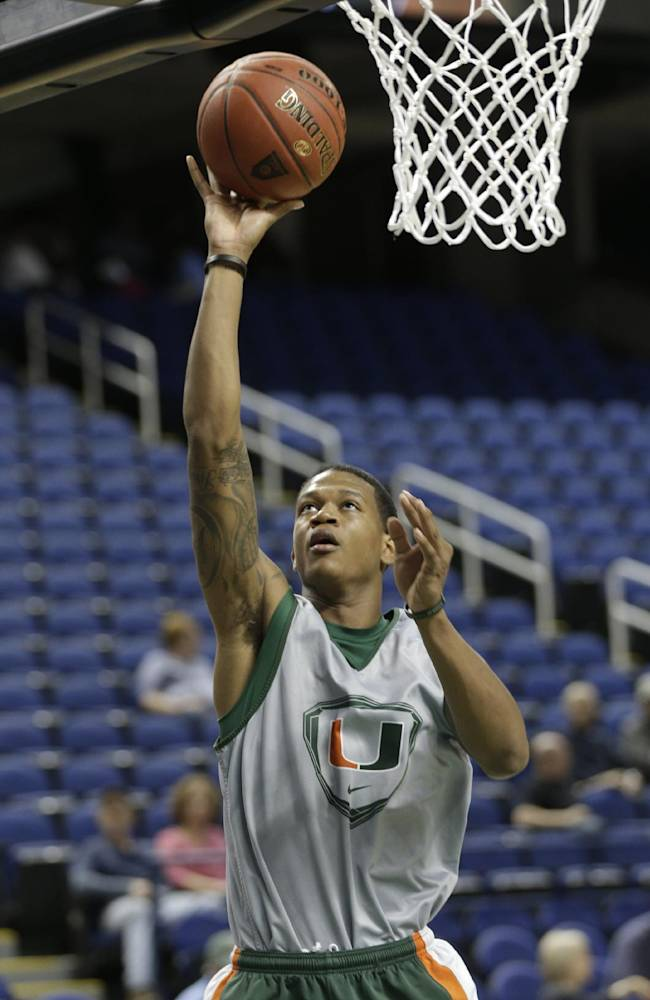 Miami's Rion Brown drives to the basket during an NCAA college basketball practice at the Atlantic Coast Conference tournament in Greensboro, N.C., Tuesday, March 11, 2014. Miami plays against Virginia Tech in a first round game on Wednesday