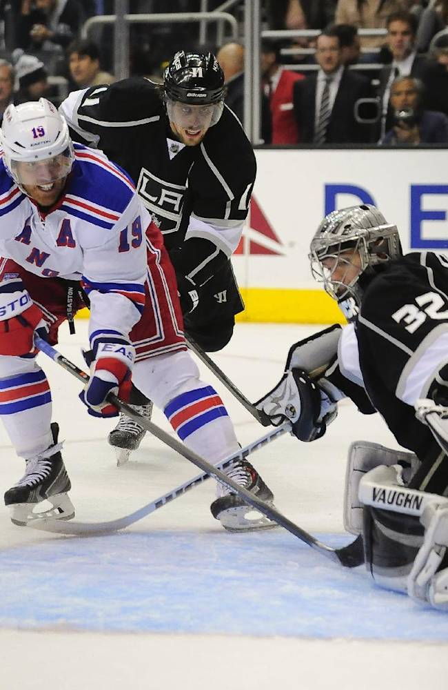 New York Rangers center Brad Richards (19) attempts to get the puck past Los Angeles Kings goalie Jonathan Quick (32) and center Anze Kopitar (11), of Slovenia, during the third period of an NHL hockey game, Monday, Oct. 7, 2013, in Los Angeles. The Rangers won 3-1
