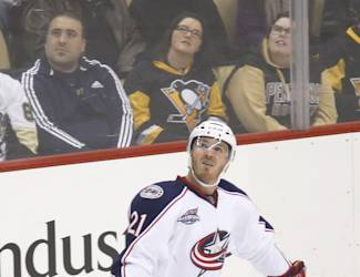 Columbus Blue Jackets' James Wisniewski (21) looks at the replay after scoring a goal against the Pittsburgh Penguins in the first period of an NHL hockey game, Sunday, March 1, 2015, in Pittsburgh. (AP Photo/Keith Srakocic)