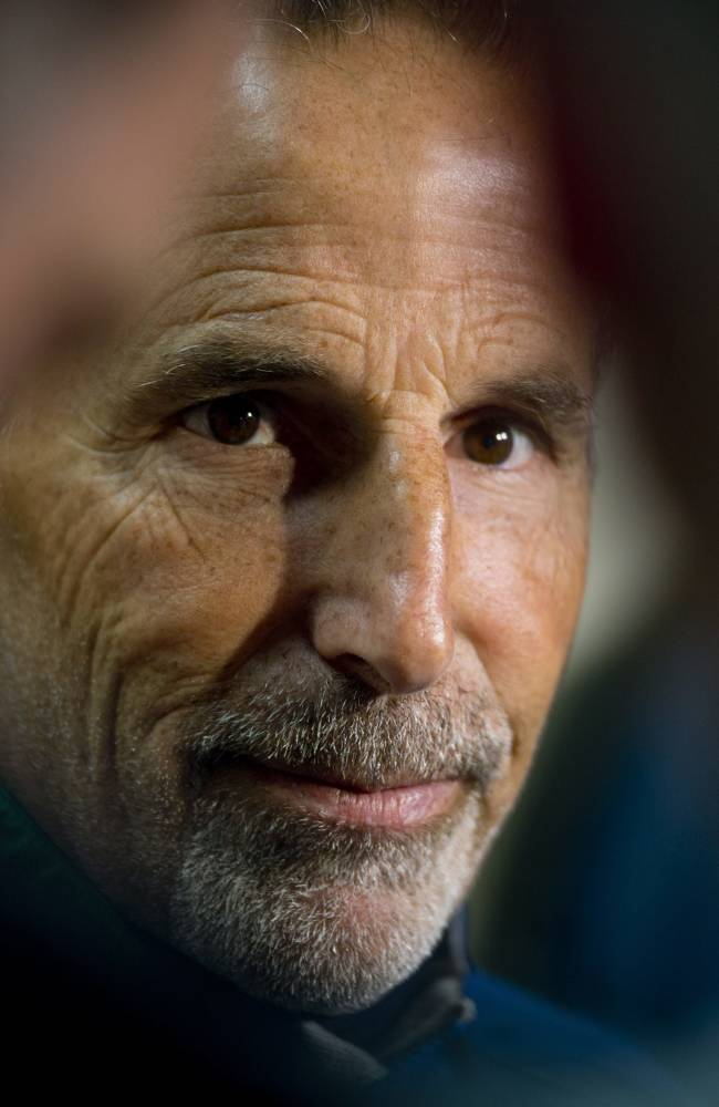 Vancouver Canucks head coach John Tortorella speaks to the media during NHL hockey training camp at UBC Arena in Vancouver, British Columbia, Thursday, Sept. 12, 2013