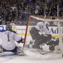 Los Angeles Kings' Dustin Brown (23) is pushed into the net by St. Louis Blues' Roman Polak(46), of Czech Republic, as St. Lo