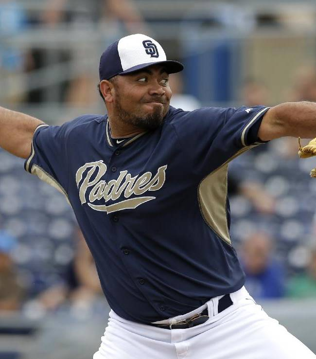 San Diego Padres relief pitcher Joaquin Benoit works against the Texas Rangers in the fifth thinning of an exhibition baseball game, Thursday, March 6, 2014, in Peoria, Ariz