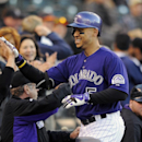 Colorado Rockies Carlos Gonzalez celebrates after hitting a solo home run in the first inning of a baseball game against the Chicago White Sox on Monday, April 7, 2014, in Denver The Associated Press