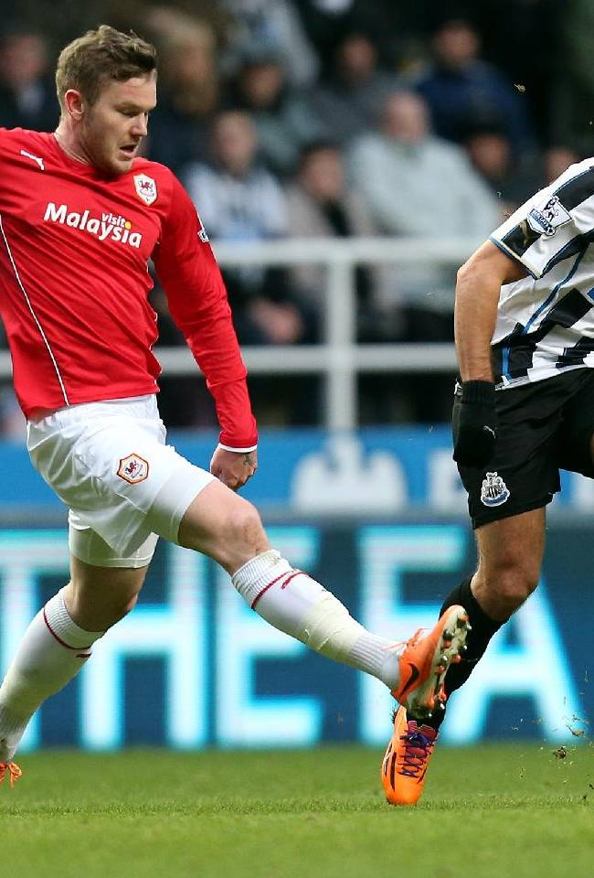 Newcastle United's Hatem Ben Arfa, right, vies for the ball with Cardiff City's Aron Gunnarsson, left,  during their English FA Cup third round soccer match at St James' Park, Newcastle, England, Saturday, Jan. 4, 2014