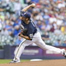 Garza rebounds from poor outing, Brewers win 9-1 The Associated Press