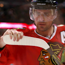 Chicago Blackhawks left wing Patrick Sharp checks the blade of his stick during a break in play during the second period in Game 3 of a first-round NHL hockey Stanley Cup playoff series game against the St. Louis Blues Monday, April 21, 2014, in Chicago T