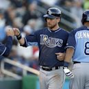 Tampa Bay Rays second baseman Ben Zobrist, center, celebrates with pitching coach Jim Hickey, left, and Desmond Jennings (8) after scoring on a two-run double by James Loney in the first inning of an exhibition baseball game against the Minnesota Twins in