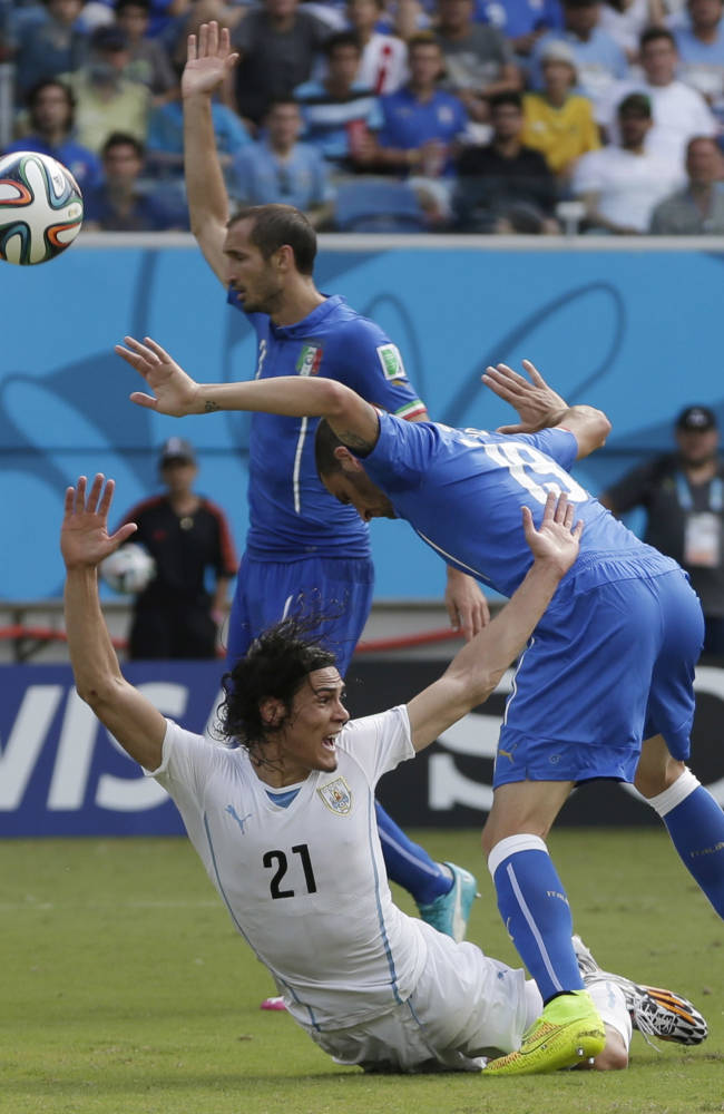 Uruguay's Edinson Cavani reacts after being tripped by Italy's Leonardo Bonucci during the group D World Cup soccer match between Italy and Uruguay at the Arena das Dunas in Natal, Brazil, Tuesday, June 24, 2014