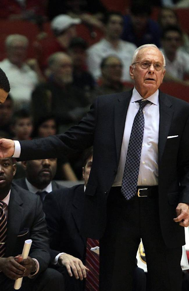SMU head coach Larry Brown right, calls SMU guard Nick Russell left, onto the floor during the first half of an NCAA college basketball game against Houston on Sunday, Jan. 26, 2014, in Houston