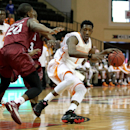 Tennessee guard Josh Richardson (1) drives to the hoop around Santa Clara guard Denzel Johnson (20) during the first half of an NCAA college basketball game in Lake Buena Vista, Fla., Thursday, Nov. 27, 2014. (AP Photo/Reinhold Matay)