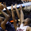 Charlotte Bobcats' Michael Kidd-Gilchrist, left, shoots as Miami Heat's Chris Bosh, center, and Dwyane Wade (3) defend during the second half in Game 2 of an opening-round NBA basketball playoff series, Wednesday, April 23, 2014, in Miami. The Heat defeated the Bobcats 101-97. (AP Photo/Lynne Sladky)