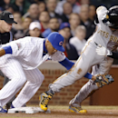 Chicago Cubs shortstop Starlin Castro tags out Pittsburgh Pirates Andrew McCutchen during the second inning of the MLB National League baseball game on Tuesday, April 8, 2014, in Chicago The Associated Press