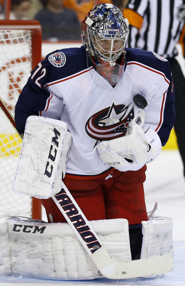 Columbus Blue Jackets' Sergei Bobrovsky, of Russia, blocks a shot during the second period of an NHL hockey game against the Philadelphia Flyers, Thursday, April 3, 2014, in Philadelphia