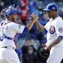 Chicago Cubs relief pitcher Pedro Strop, right, celebrates with catcher Welington Castillo after the Cubs defeated the Cincinnati Reds 8-4 in a baseball game in Chicago, Saturday, April 19, 2014 The Associated Press