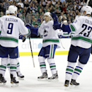 Vancouver Canucks' Zack Kassian (9) is congratulated on his goal against the Dallas Stars by Chris Tanev, center, and Alexander Edler (23), of Sweden, during the second period of an NHL hockey game, Tuesday, Oct. 21, 2014, in Dallas The Associated Press
