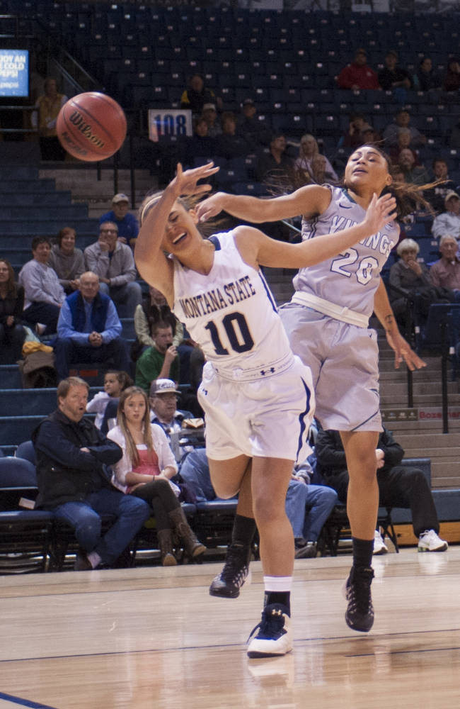 In this photo provided by Montana State University, Montana State center Margreet Barhoum is fouled by Portland State's Lariel Powell during the first half of an NCAA college basketball game on Thursday, Jan. 9, 2014, in Bozeman, Mont