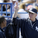 New York Yankees pitching coach Larry Rothschild, right, talks with pitcher Ivan Nova, left, during the third inning of an exhibition baseball game against the Washington Nationals Monday, March 3, 2014, in Tampa, Fla The Associated Press