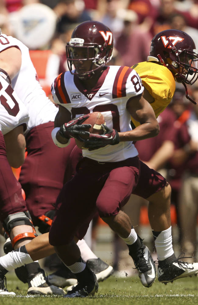 Virginia Tech's Demitri Knowles (80) takes a hand-off from quarterback Brenden Motley, in yellow jersey, for a 52-yard run during the first half of their spring NCAA college football game in Blacksburg, Va., Saturday April 26 2014