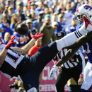 New England Patriots' Julian Edelman (11) is defended by Buffalo Bills strong safety Duke Williams (27) during the first half of an NFL football game Sunday, Oct. 12, 2014, in Orchard Park, N.Y The Associated Press