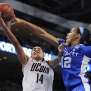 Kentucky's Jelleah Sidney, right, stops a shot attempt by Connecticut's Bria Hartley, left, during the second half of a regional final game in the NCAA college basketball tournament in Bridgeport, Conn., Monday, April 1, 2013. (AP Photo/Jessica Hill)