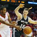 HOUSTON, TX - OCTOBER 24:  Trevor Ariza #1 of the Houston Rockets passes the ball in front of Aaron Baynes  #16 of the San Antonio Spurs during their preseason game at Toyota Center on October 24, 2014 in Houston, Texas NOTE TO USER: User expressly acknowledges and agrees that, by downloading and/or using this photograph, user is consenting to the terms and conditions of the Getty Images License Agreement. Mandatory copyright notice:  (Photo by Scott Halleran/Getty Images)