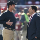 San Francisco 49ers head coach Jim Harbaugh, left, talks with owner Jed York before an NFL football game against the Arizona Cardinals in Santa Clara, Calif., Sunday, Dec. 28, 2014. (AP Photo/Tony Avelar)